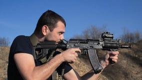 Man firing customised russian machine gun, medium stock video
