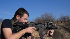 Man firing customised russian machine gun, medium stock video footage