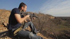 Man firing customised russian machine gun, wide stock footage