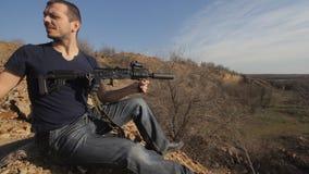 Man firing customised russian machine gun, wide stock video footage