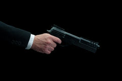 A man firing a gun on black Royalty Free Stock Image