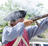 Man firing musket Royalty Free Stock Images