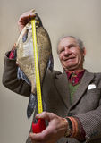 Man and fish. Royalty Free Stock Image