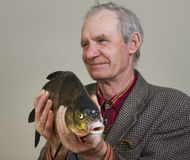 Man and fish. Royalty Free Stock Photos