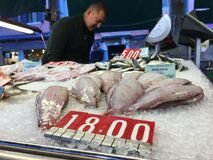 Man at fish market Stock Photo
