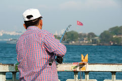 Man fishes from the Galata bridge in Istanbul Royalty Free Stock Photo