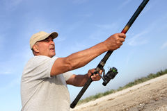 Man fishes with spinning Royalty Free Stock Photography