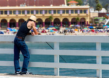 Man Fishes From Wharf stock photos