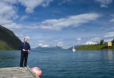 Man fishing. A man fishing in a Norwegian fjord Royalty Free Stock Images