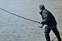 Man on fishing 13. A man with spinning rod on fishing Stock Photos