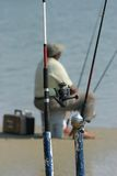 Man fishing. Standing on the shore Royalty Free Stock Image