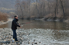 Man on fishing 14. A man with spinning rod on fishing Royalty Free Stock Images