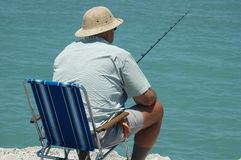 Man Fishing. Photographed a man fishing from a local jetty in Florida Royalty Free Stock Photo