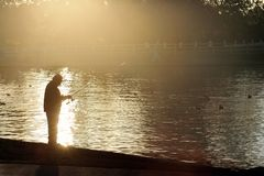 Man fishing. Silhouette of a man fishing at sunset Stock Photography