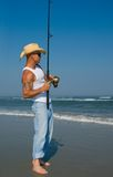 Man Fishing. On beach on a nice summer day Royalty Free Stock Images