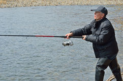 Man on fishing 8. A man with spinning rod on fishing Stock Photography
