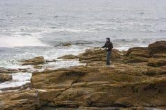 A man fishing alone in Carlingford Lough near Newcastle stock image