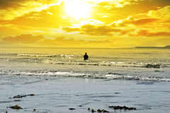 Man Fishing Among The Waves Royalty Free Stock Photos