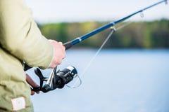 Man fishing with angle at lake Royalty Free Stock Photos