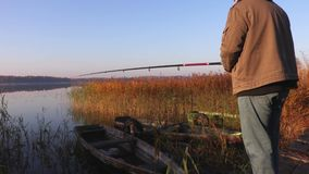 Man is fishing on autumn day stock video footage