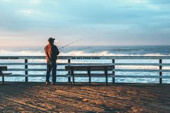 Man Fishing at Beach Against Sky Royalty Free Stock Photo