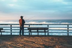 Man Fishing at Beach Against Sky Stock Photography