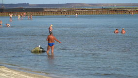 A man fishing at the beach stock footage