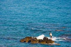 Man  fishing at the beach Stock Image