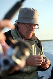 Man in fishing boat. Old man sitting in fishing boat Royalty Free Stock Images