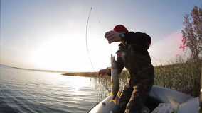 Man fishing from the boat stock footage