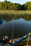 A man is fishing from a boat. View from behind the shoulder of a man, you can see the fishing rod and the float Royalty Free Stock Photo