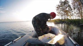 Man fishing from the boat stock video