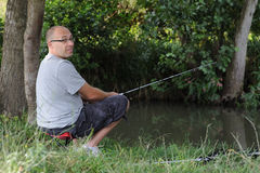 Man fishing in creek Royalty Free Stock Photos