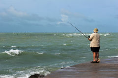 Man Fishing from Dock Stock Photography