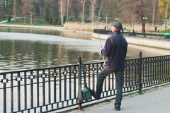 A man is fishing for the evening in the lake stock photo