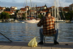 Man fishing with fishing line in Trogir town Royalty Free Stock Image