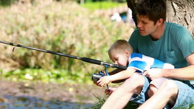 Man fishing with his little boy Royalty Free Stock Photo