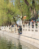 Man fishing in Houhai lake on a sunny day, Beijing, China. BEIJING-APRIL 14, 2007. Man fishing in Houhai Lake. Houhai Lake is very popular among foreign tourists Royalty Free Stock Photography