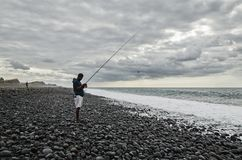 Man is fishing in the ocean Royalty Free Stock Photo