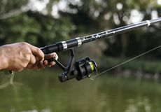 Man fishing in the jungle Stock Photography