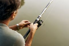 Man fishing in the jungle Stock Images