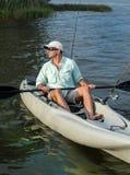 Man Fishing in Kayak royalty free stock image