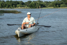 Man Fishing in Kayak Royalty Free Stock Images