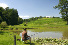 Man fishing by the lake Stock Image