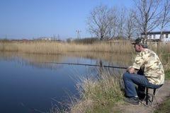 Man fishing at lake royalty free stock photo
