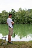 Man Fishing at a lake Stock Image