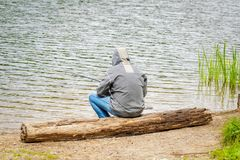 Man fishing by the lake Royalty Free Stock Photography