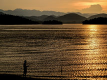 Man fishing on a lake Stock Photo