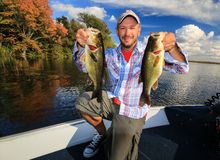 Man Fishing Large Mouth Largemouth Bass in Fall stock image