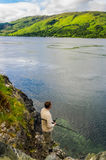 Man fishing at Loch Duich in Scotland Stock Photos